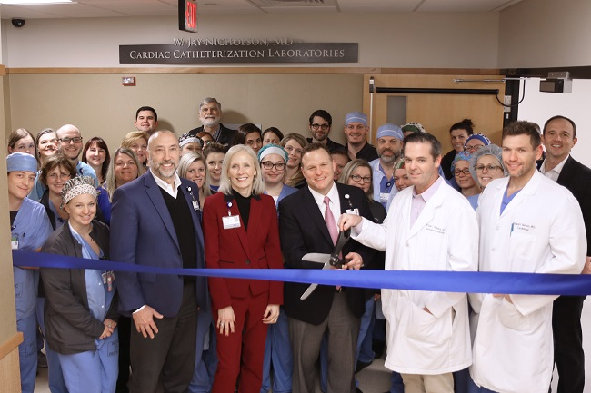 The cardiac catheterization lab team at WellSpan York Hospital is joined by WellSpan Health leadership to cut the ribbon to the expanded space.